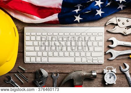 Happy Usa Labor Day Concept, Different Kinds Wrenches With The American Flag And Computer Keyboard.