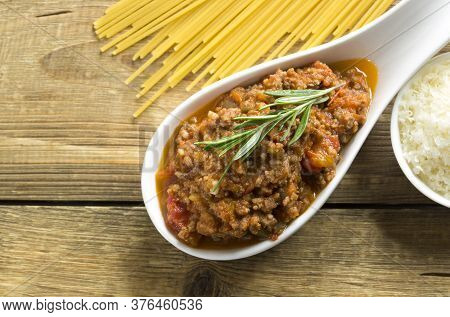 Meat Bolognese Sauce On A Wooden Table. Traditional Italian Recipe