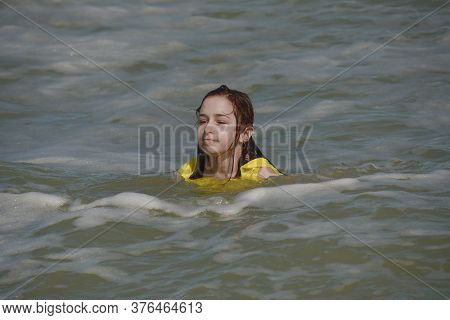 Girl At Sea. Teenager Summer Vacation Sand. Sunny Day And The Sea. Travel Vacation. Teenager In A Ye