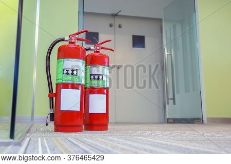 Red Fire Extinguishers Tank At The Exit Door In The Building Concepts For Emergency Safety Fire Prev