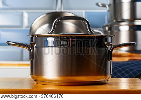 Set Of Aluminum Cookware On Kitchen Counter