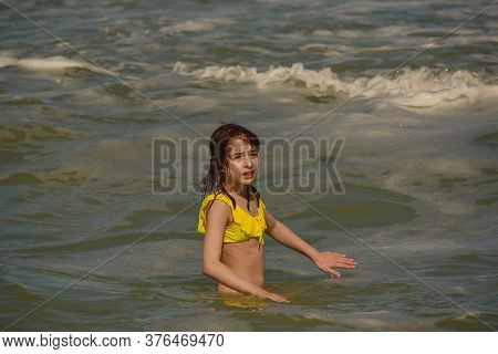 Girl At Sea. The Portrait Of The Young Girl. Teenager Summer Vacation Sand. Sunny Day And The Sea. C