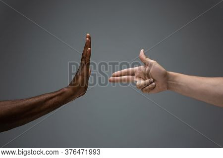 Stop Shaming. Racial Tolerance. Respect Social Unity. African And Caucasian Hands Gesturing On Gray