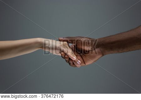 Romance, Relations. Racial Tolerance. Respect Social Unity. African And Caucasian Hands Gesturing On