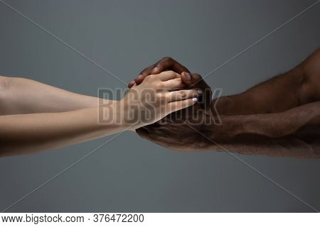 Supporting Hands. Racial Tolerance. Respect Social Unity. African And Caucasian Hands Gesturing On G