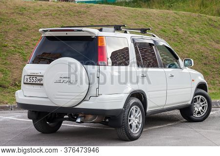 Novosibirsk, Russia - 07.07.20: Rear View Of A White Japanese Suv Of The Honda Cr-v Brand With A Spa