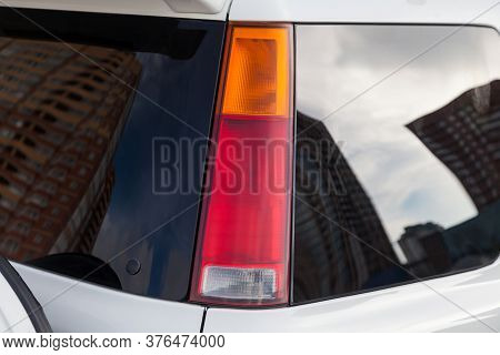 Close-up Of A Red Led Rear Brake Light Replaced After An Accident On A White Car In The Back Of An S