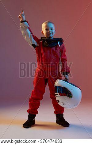 Boy Child Racer With Helmet And His Hand Up, Standing In Neon Light. Kart Racing School Poster. Comp