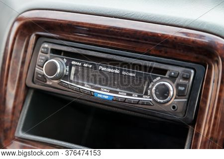 Novosibirsk, Russia - 07.07.20: Plastic Panel Of Central Unit Of Brown Color With A Panasonic Music