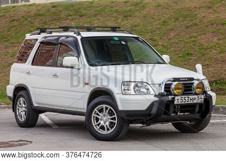 Novosibirsk, Russia - 07.07.20: Front View Of A Honda Cr-v Car In A White Body Japanese Two Thousand