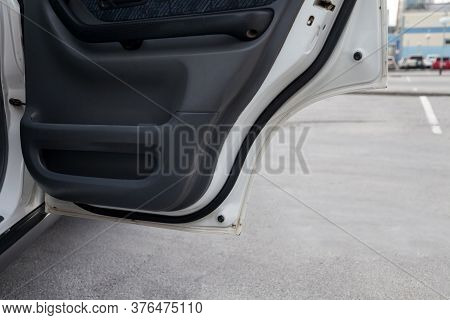 Close-up Open Door Of A White Car With A Black Panel In The Interior Finished With Fabric After Dry