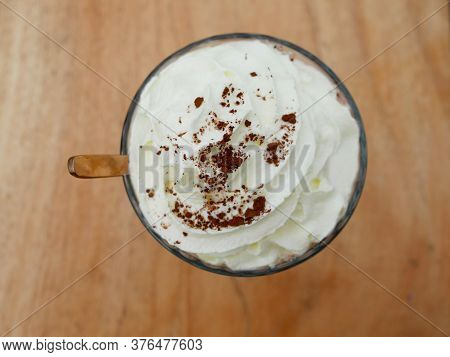 Chocolate Frappe Or Chocolate Ice Blended Topped With Whipped Cream And Cocoa Powder