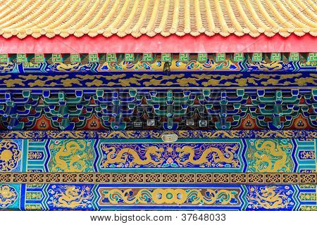 Detail View Of Chinese Temple, With Colorful Details Of Wooden Facade