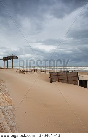 The Sand-covered Tables On The Beach In Egmont Aan Zee, Netherlands. The Beach Without Foreign Touri