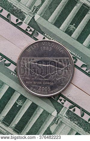 A Quarter Of West Virginia On Us Dollar Bills. Symmetric Composition Of Us Dollar Bills And A Quarte