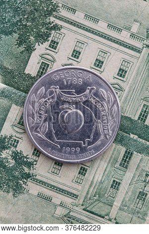 A Quarter Of Georgia On Us Dollar Bills. Symmetric Composition Of Us Dollar Bills And A Quarter Of G