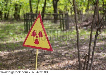 Radiation sign on a graveyard in abandoned Pripyat city in Chernobyl Exclusion Zone, Ukraine