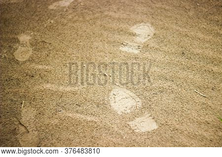 Footprints In The Sand, Walking In The Sand, Wet Footprints In The Sand