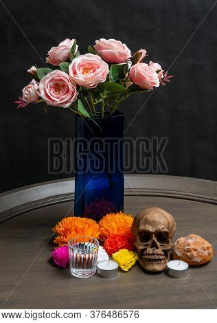 Altar For Day Of The Dead. Skull, Bread, Flowers, Candles And Roses On Black Background