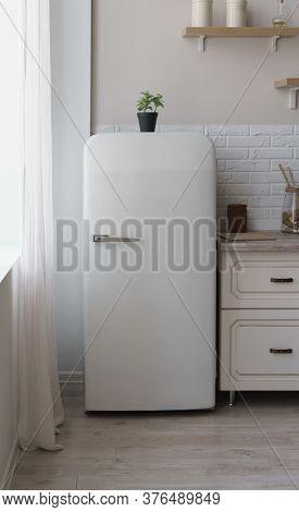 Vintage Retro Style White Fridge In Bright Kitchen