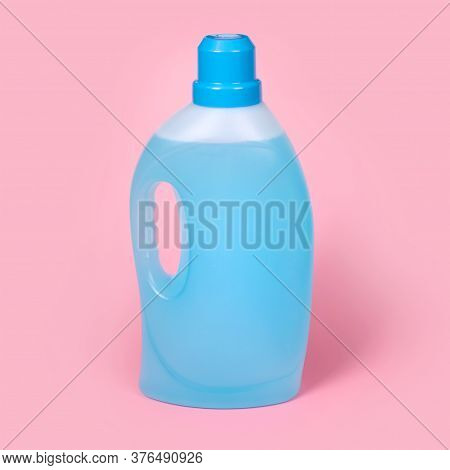 Bottle Of Detergent On Pink Background. Plastic Container Of Cleaning Product, Household Chemicals O