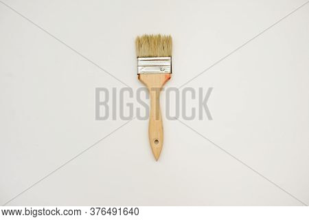 A Natural Wooden Brush, Close View On White Background