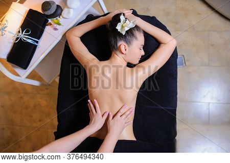 Women Laying Down On The Massage Bed In The Spa