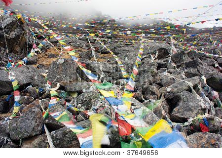 coloring buddhist prayer flags in Nepal arround gosaikund lake poster
