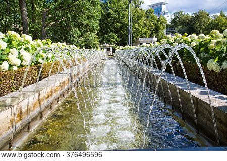The Fountain Is Urban In The Form Of A Water Jet Channel On Both Sides. Rest Of The Urban Environmen