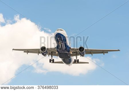 Passenger Jet On Landing Approach To An Airport With Its Undercarriage Down