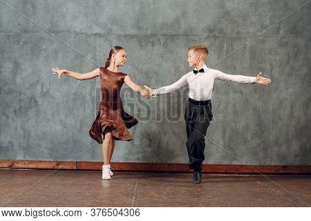 Young Dancers Boy And Girl Dancing In Ballroom Dance Samba