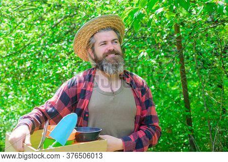 Happy Bearded Man In Garden. Garden Tools. Gardening. Eco-farm. Work In Garden. Bearded Man With Gar