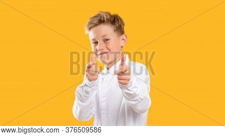Encouraging Gesture. Admiration Support. Confident Boy Pointing Fingers Smiling Isolated On Orange B
