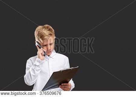 Children In Business. Progressive Generation. Smart Boy Working On Project Talking On Phone Isolated