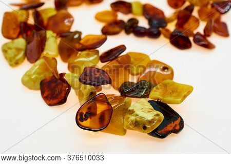 Necklace Made Of Natural Multi-colored Amber. Solid Translucent Fossilized Resin From Extinct Tertia