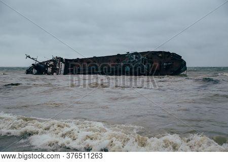 Odessa, Ukraine - November, 22 2019: A Shipwreck Of A Tanker Delfi At The Black Sea Coast. Ecologica