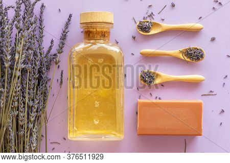 Lavender Soap, Lavander Oil And Bouquet On Violet Background, Homemade Cosmetics, And Beauty Concept
