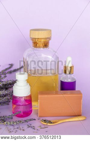 Lavender Soap, Lavande Oil, Lavander Hydrolyte And Bouquet On Violet Background, Homemade Cosmetics,