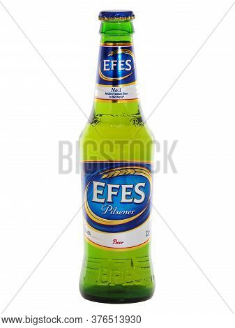 Bucharest, Romania - May 29, 2015. Efes Pilsener Glass Bottle Beer Isolated On White, A Brand Owned