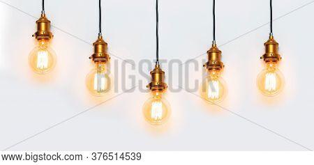Creative Idea Concept, Designer Lamp, Modern Interior Item. Vintage Fashionable Edison Lamp On Light