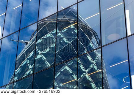 London, Uk - 06 March, 2020- Reflection Of The Gherkin, 30 St Mary Axe, In The Glass Exterior Of The