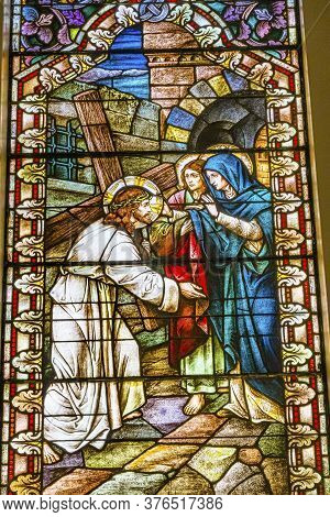 San Antonio, Texas - October 8, 2019 Jesus Christ Carrying Cross Virgin Mary Stained Glass Saint Mar