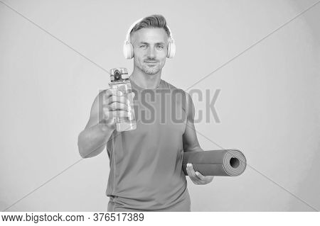 Health Is Priority. Healthy Man Hold Water For Yoga Training. Fitness Coach Blue Background. Water A