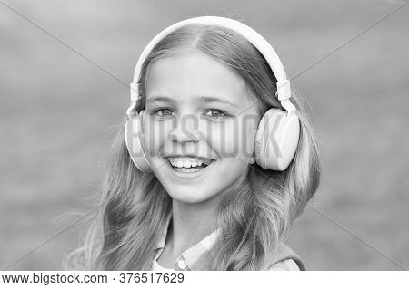 Music Is Life. Happy Child Listen To Music Outdoors. Little Girl Wear Headphones Playing Music. Musi