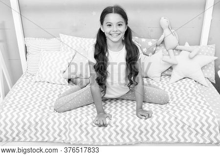 Pediatric Care. Happy Kid Sit On Bed. Little Baby With Healthy Smile. Childhood Care. Child Care And