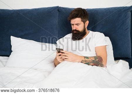 First Of All. Bearded Man Texting Sms In Bed. Hipster Send Message Using Smartphone. Mobile Message.