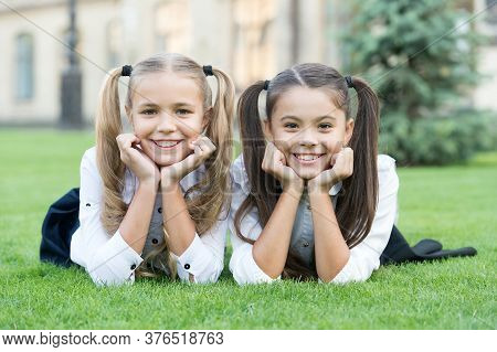 Find Happiness In Simple Things. Happy Children Relax On Green Grass. Enjoying Happiness. Small Girl