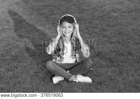 Listen Music While Relaxing Outdoors. Educational Podcast. Enjoy Every Moment. Kid Girl Enjoy Music