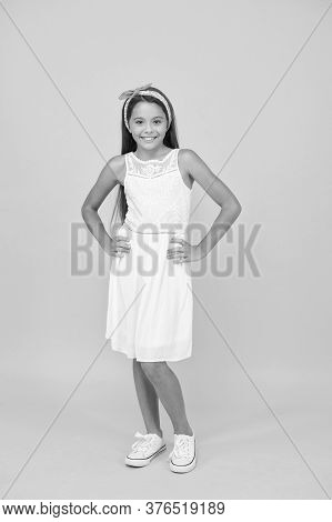 Keeping Up With Fashion Trends. Fashion Little Model Yellow Background. Happy Child Enjoy Fashion St