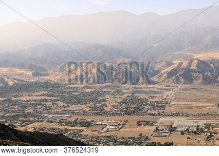Overlooking The Town Of Banning, Ca Surrounded By Mountains With A Layer Of Haze From The California